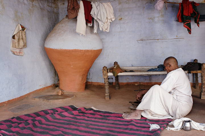 Bishnoi farmer preparing beverage